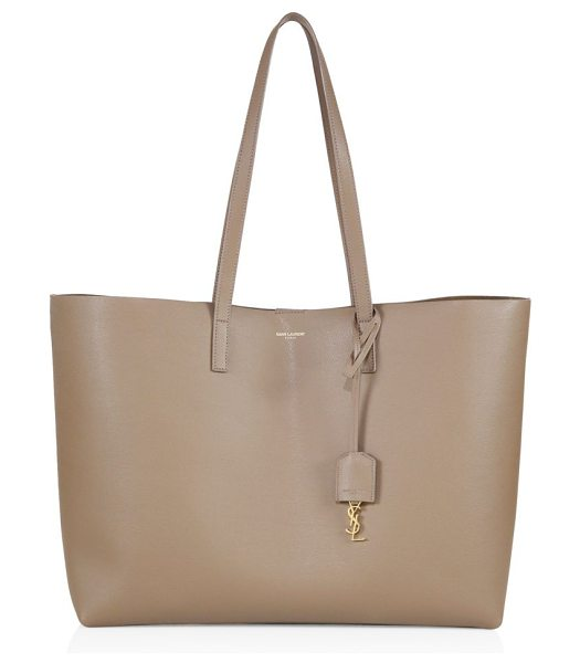 Saint Laurent large leather shopping tote in taupe - Crafted of soft, supple leather, this spacious shopper...