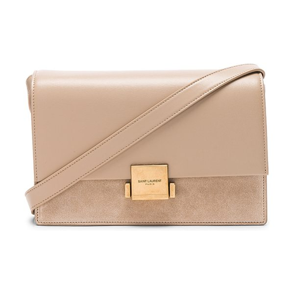 "Saint Laurent Medium Bellechasse Satchel in neutrals - ""Calfskin leather with raw lining and brushed gold-tone..."