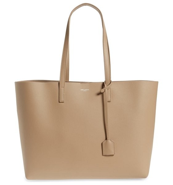 Saint Laurent medium east/west leather shopping tote in beige