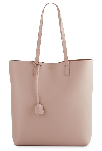 SAINT LAURENT Medium North-South Shopping Tote Bag in pink - Saint Laurent calfskin shopping tote bag. Available in...
