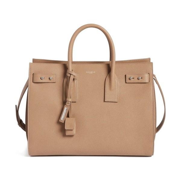 Saint Laurent medium sac de jour grained leather tote in taupe - Sleek rolled handles and an optional shoulder strap give...