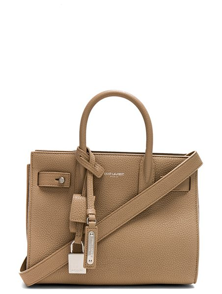 "Saint Laurent Nano Supple Sac de Jour in neutrals - ""Supple calfskin leather with raw lining and brushed..."