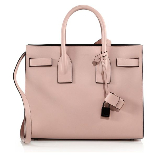 Saint Laurent sac de jour small leather tote in rose - Signature silhouette with belted detail and glossy black...