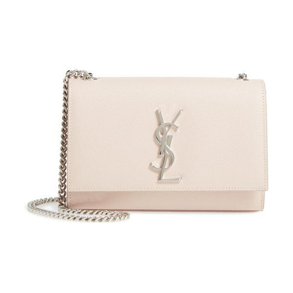 Saint Laurent small kate grained leather crossbody bag in marble pink - A gleaming monogrammed insignia makes an iconic mark on...