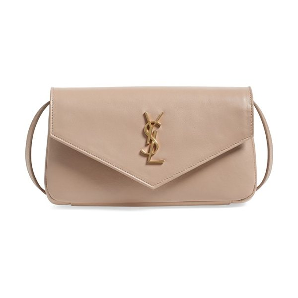 SAINT LAURENT Small monogram leather crossbody bag in dark beige - An iconic gilt insignia proclaims your label loyalty on...