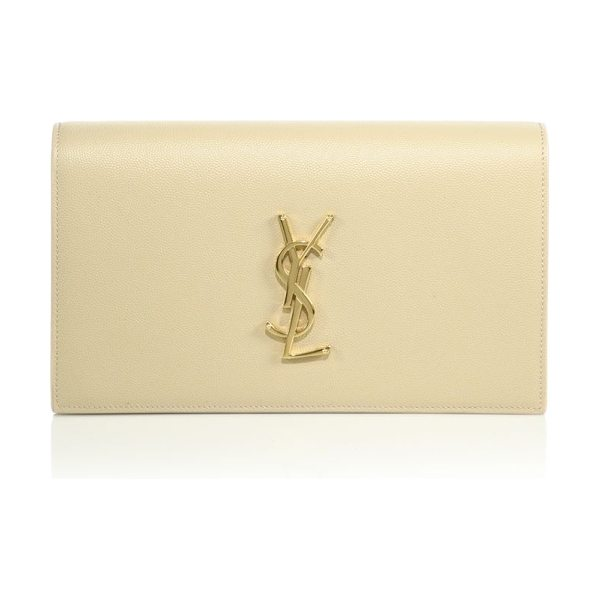 Saint Laurent small monogram leather clutch in nude - Signature logo polishes textured leather clutch....