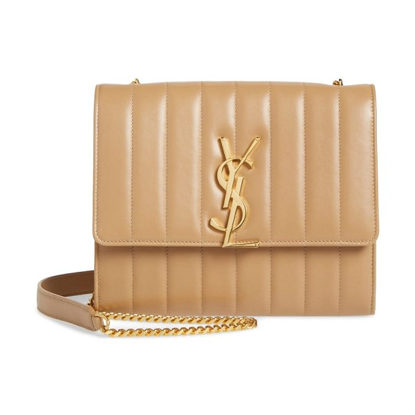 Saint Laurent small vicky leather wallet on a chain in beige