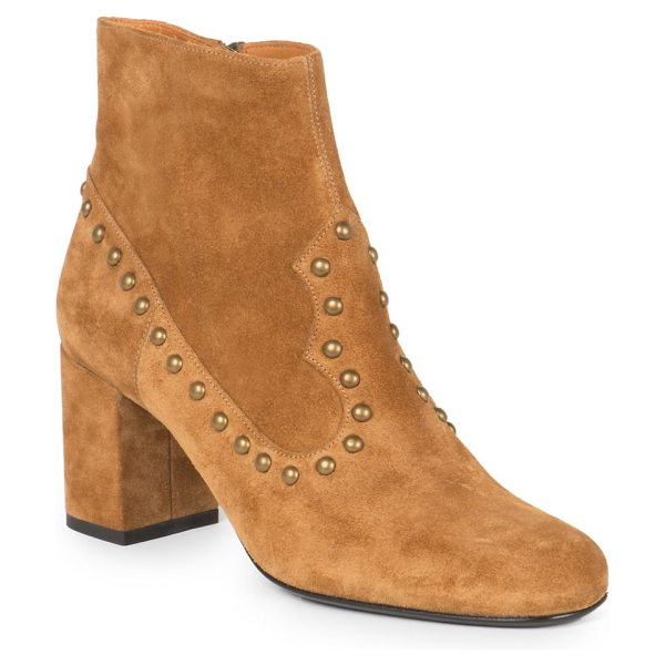 Saint Laurent Studded suede ankle boots in tan - Shiny metal studs punctuate this suede design, crafted...