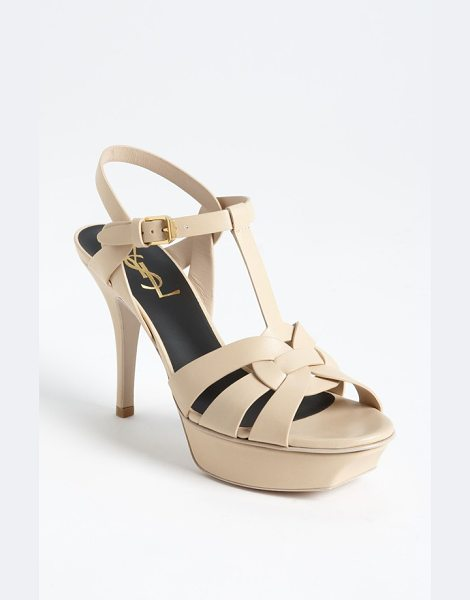 SAINT LAURENT paris tribute sandal in nude - Interlocking straps of smooth leather form a breezy...