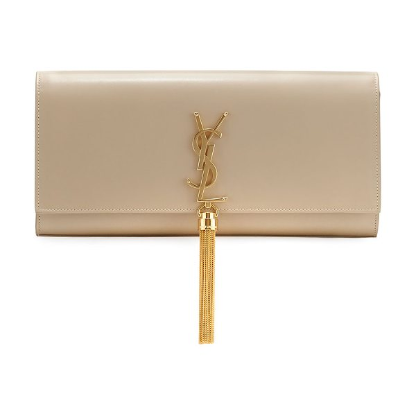 Saint Laurent Monogram full-flap clutch bag in beige - Saint Laurent calfskin clutch bag. Fold-over top with...