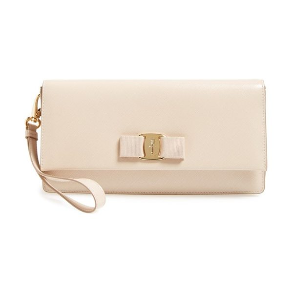 SALVATORE FERRAGAMO Camy clutch in new bisque - A grosgrain bow and logo-etched goldtone hardware...
