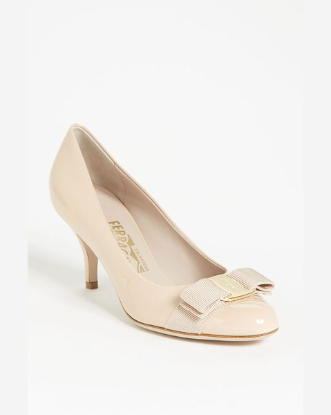 SALVATORE FERRAGAMO carla pump - A signature grosgrain bow accents a shiny patent leather...