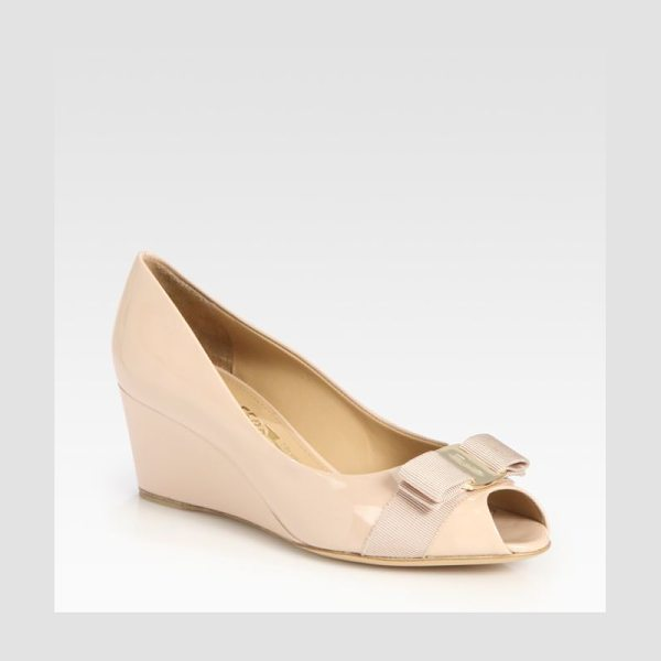Salvatore Ferragamo sissi patent leather wedge pumps in beige - A logo-detailed bow adorns this patent leather pump with...