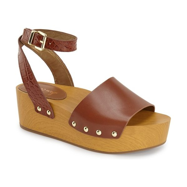 Sam Edelman brynn sandal in saddle leather - A chunky wood-like platform sandal channels '70s glam...