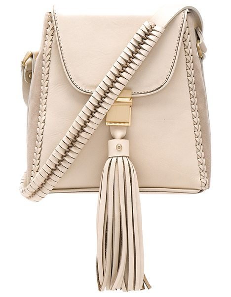 SANCIA Milla Jet Set Mini Bag - Leather exterior with poly fabric lining. Flap top with...