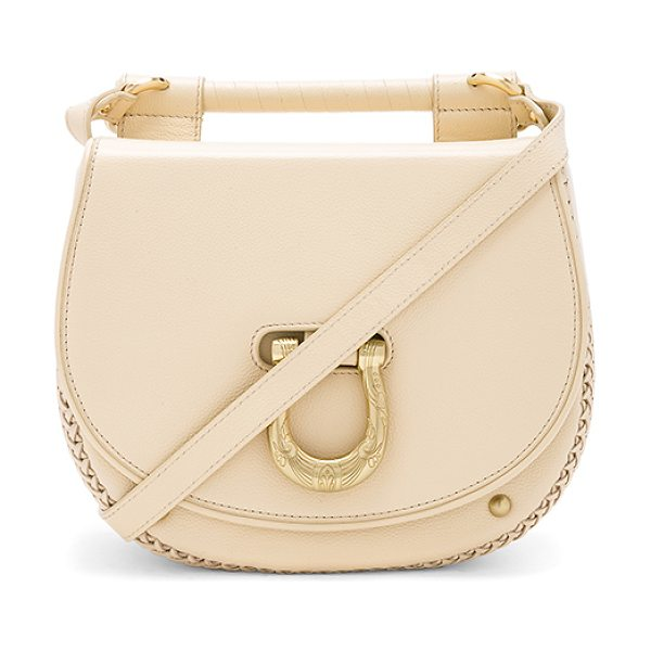 "SANCIA The Babylon Bar Bag in cream - ""Leather exterior with fabric lining. Flap top with..."