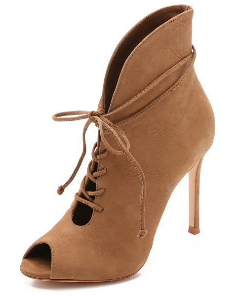 Schutz Kafalin open toe booties in sand stone - The curved top line flows into a lace up closure on...