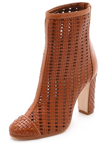 Schutz Kiula woven booties in caramel - A patterned, woven leather upper lends texture to unique...