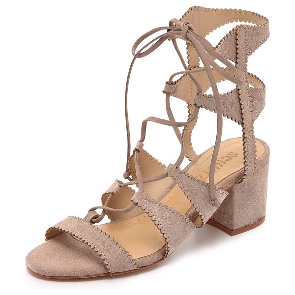 Schutz Latisha city sandals in neutral - These lace up Schutz sandals are fashioned in scalloped...