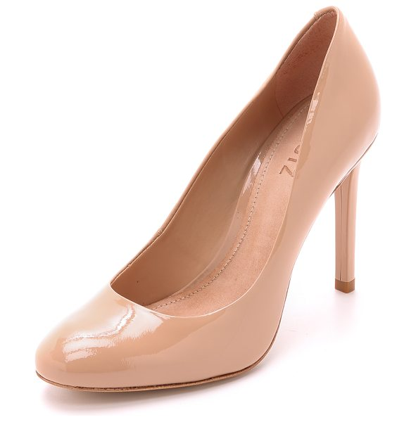 Schutz Oxia pumps in peach - A gently rounded toe lends timeless appeal to patent...