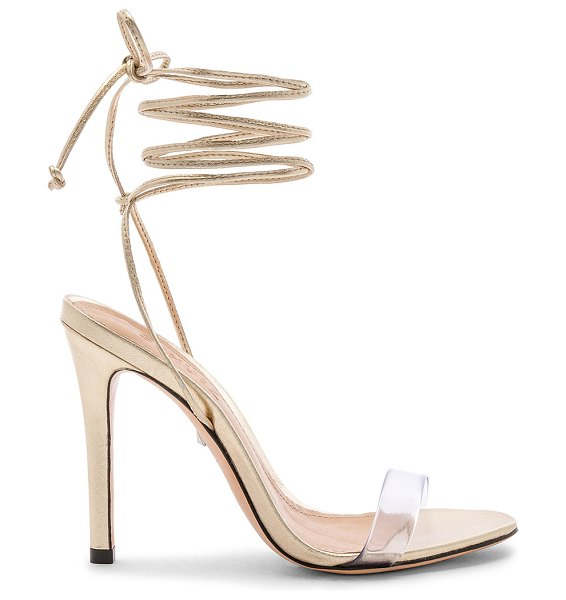 """Schutz X REVOLVE Felice Sandal in metallic gold - """"Translucent PVC and metallic leather upper with leather..."""