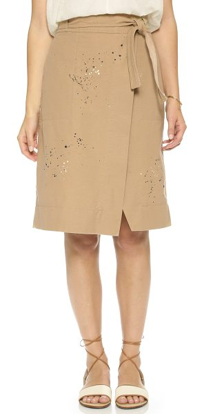 SEA Wrap skirt in camel - Paint spatters lend casual appeal to the crossover front...