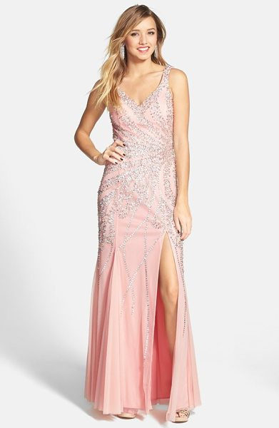 Sean Collection beaded gown in blush - Beams of beads call attention to the waist of a...