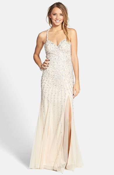 Sean Collection sequin sweetheart mesh gown in champagne - Streaming sequins burst from the sweetheart neckline and...