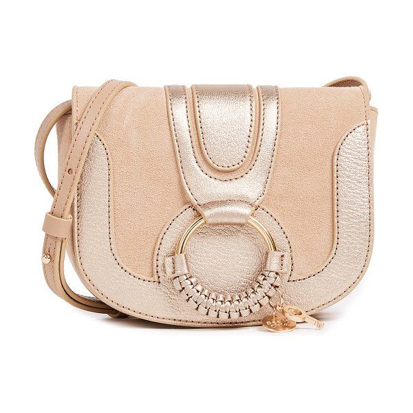 SEE BY CHLOE hana mini saddle bag in pearl beige - A petite See by Chloé saddle bag in metallic leather and...