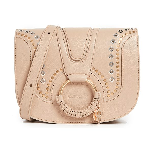 See By Chloe hana saddle bag in pearl beige - Two-tone, polished grommets add bold, edgy style to this...