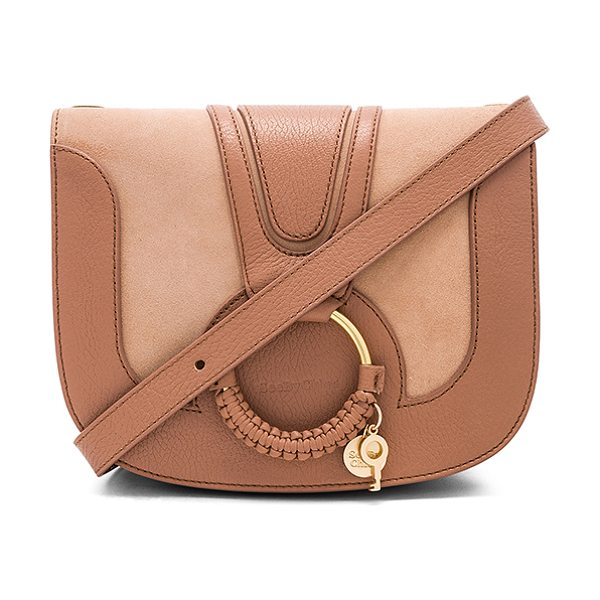 "See By Chloe Hana Small Crossbody in brown - ""Leather exterior with canvas lining. Flap top with..."