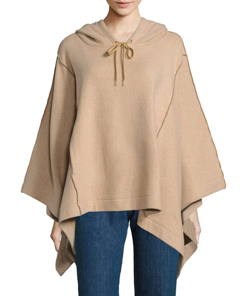 See By Chloe hooded knit poncho in camel - Exposed seams outline hooded knit poncho. Attached...