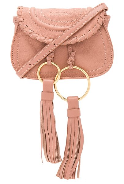 """See By Chloe Polly Mini Crossbody Bag in pink - """"Leather exterior with canvas lining. Flap top with..."""