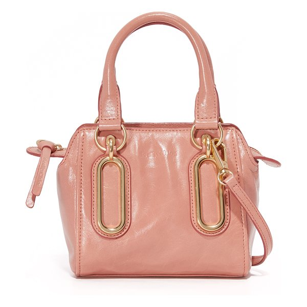 See By Chloe paige cross body bag in misty pink - Polished ovals detail the front of this glazed leather...