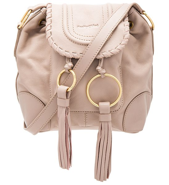 See By Chloe Polly Shoulder Bag in blush - Leather exterior with fabric lining. Flap top with...