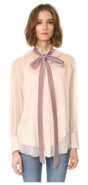 See By Chloe tie neck blouse in powder - A high, ruffled neckline and velvet tie lend Victorian...