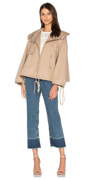 See By Chloe Short Trench Coat in beige - 100% cotton. Dry clean only. Double breasted button...