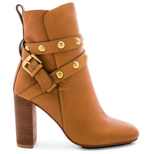 "See By Chloe Studded Ankle Strap Heeled Bootie in brown - ""Leather upper with man made sole. Pull-on styling. Gold..."