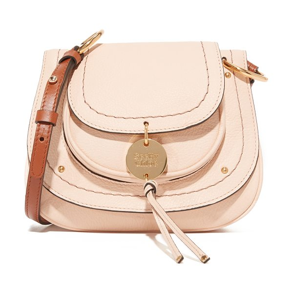 See By Chloe susie small saddle bag in nude - A pouch pocket with a decorative logo charm covers the...