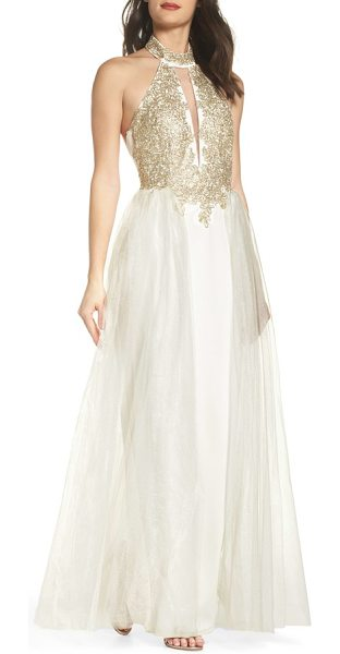 SEQUIN HEARTS embellished halter gown with tulle overskirt in ivory/ gold - A stunning lace applique glimmering with metallic...