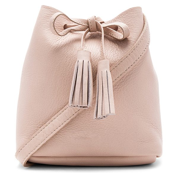 Shaffer The Greta Bucket Bag in blush - Leather exterior with raw leather lining. Drawstring top...