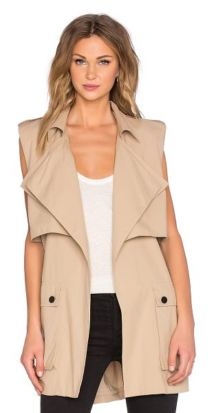 Shakuhachi Out of africa sleeveless trench in tan - 100% cotton. Self tie waist. Flap pockets with button...