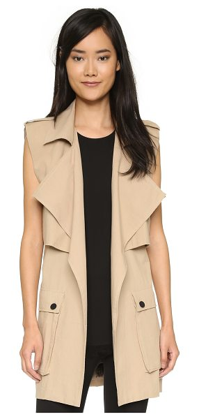Shakuhachi Sleeveless trench coat in stone - Description NOTE: Sizes listed are Australian. Please...