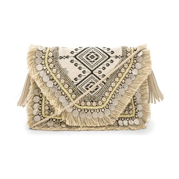 "Shashi Alexa Clutch in beige - ""Embroidered textile exterior with cotton fabric lining...."