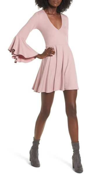 Socialite bell sleeve knit dress in pink adobe - Flowy bell sleeves and a swingy miniskirt add fun...