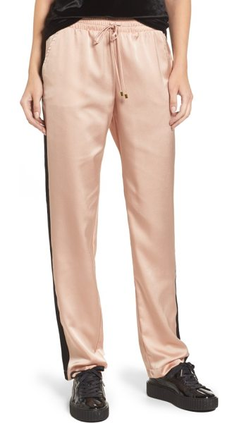 Socialite satin track pants in pink/ black stripe - Embrace the athluxury trend with these relaxed,...