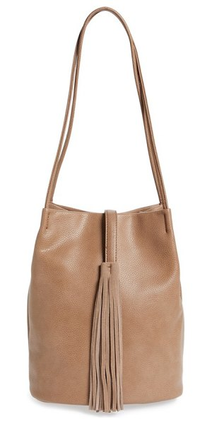 SOLE SOCIETY 'ariana' faux leather tassel bucket bag - Smooth faux leather distinguishes a versatile bucket bag...
