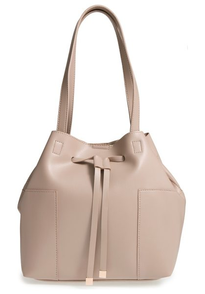 Sole Society jocelynn faux leather bucket bag in cream - Metal-tipped drawstring straps cinch the top of a roomy...