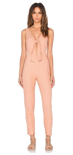 Solid & Striped The jumpsuit in peach - 100% silk. Front cut-out with tie closure. Back hidden...