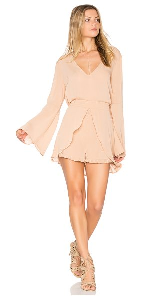 """Somedays Lovin Touch the Sun Playsuit in tan - """"100% poly. Smocked waist with tie. Skirt overlay. Back..."""